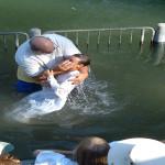 Baptising grandson in Jordan River